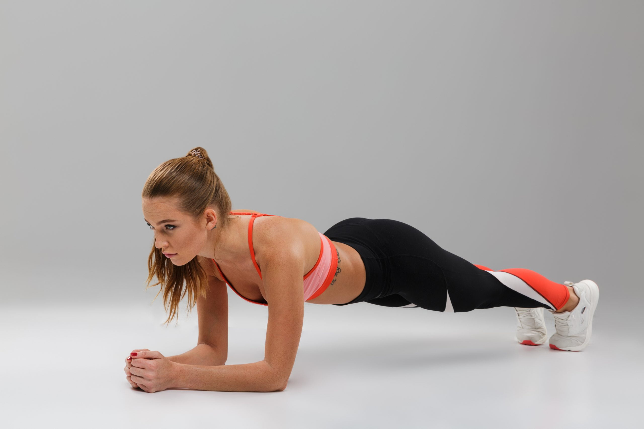 Woman doing plank for a flat stomach
